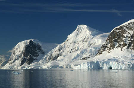 neko: Mountains & glaciers with icefalls emptying into the ocean,,  Neko Harbor, Andvord Bay, Antarctica   Stock Photo