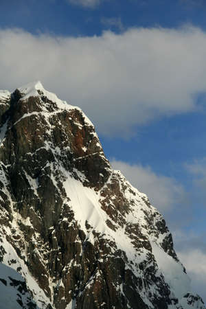 Jagged peak with hanging snowfields,  Lemaire Channel, Antarctica