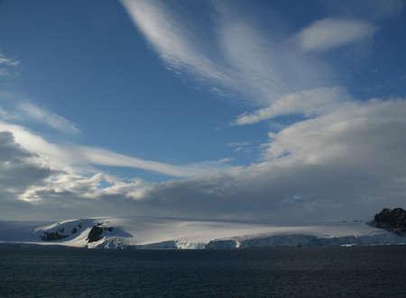 Polar twilight: clouds & blue sky with glaciers  Paradise harbor,  Antarctica   版權商用圖片