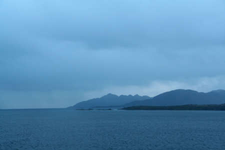 Shadowy blue ridges on overcast day,  Martinez Fjord,  Patagonia, Chile   Фото со стока