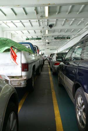 edmonds: Lines of cars on lower deck,  Edmonds - Kingston Washington State Ferry, Pacific Northwest, Washington   Stock Photo