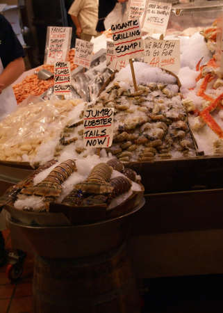 scampi: Alaskan King Crab & scampi on ice; fresh seafood market, Pike Place Market Seattle Pacific Northwest   Stock Photo