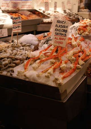 pike place: Alaskan King Crab & scampi on ice; fresh seafood market, Pike Place Market Seattle Pacific Northwest   Stock Photo