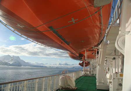 Life boats and cruise ship deck,twilight on calm ocean,  Neko Harbor, Andvord Bay, Antarctica   版權商用圖片