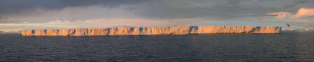Tabular iceberg, sunset glow,  Bransfield Strait,  Antarctica