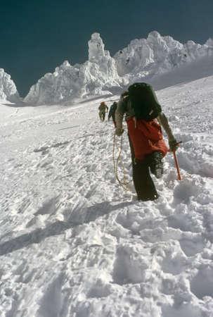 steep: Climbers on steep snow,  Mt Hood, West Side Cascade mountain range, Oregon