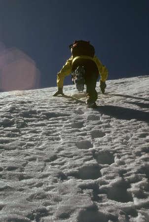sherpa: Climber kicking steps up steep snow face, , Sherpa peak  Cascades Washington   Stock Photo