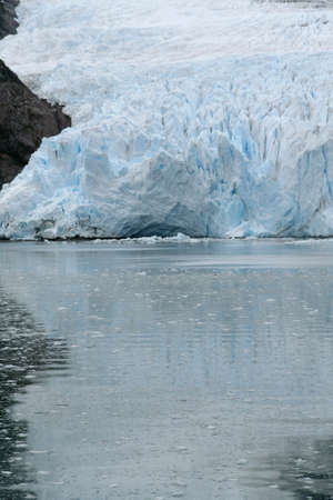 strait of magellan: Ice fall from glacier, and brash ice at twilight, Strait of Magellan,  Patagonia, Chile   Stock Photo