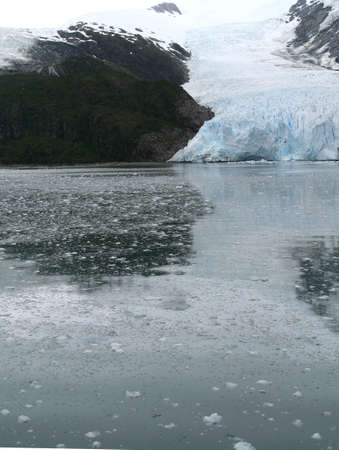 brash: Ice fall from glacier, and brash ice at twilight, Strait of Magellan,  Patagonia, Chile   Stock Photo