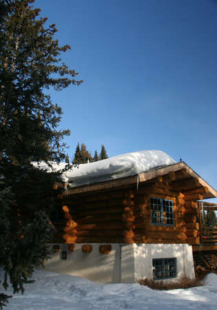 Mountain hut with snow on roof,  Shrine pass, near Vail Pass,  Colorado   Stock Photo