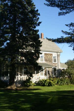cape cod style: New England white house with porch & hammock,  Manset, Mount Desert Island, Acadia National park, Maine, New England   Stock Photo