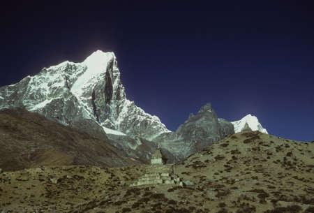 Chorten, Buddhist, and Himalayan peaks,  Khumbu Nepal