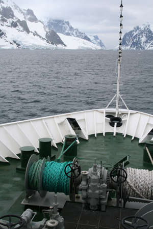 ship bow: Bow of cruise ship, entering narrow channel,  Lemaire Channel, Antarctica