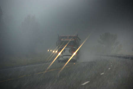 snowstorm: Trucks moving through fog and snowstorm,  Rocky Mountains, Idaho