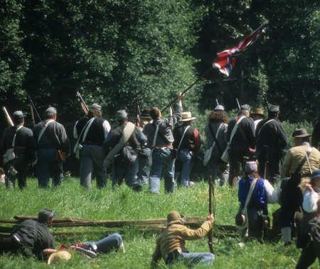 reenactment: Confederate soldiers advance,   Civil War battle reenactment