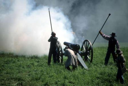 Artillery firing, during  Civil War battle reenactment