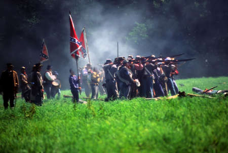 civil war: Confederate soldiers advance,  Civil War battle reenactment