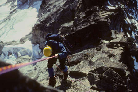 abseil: Climber rappelling, West Ridge, Forbidden Peak North Cascades National Park, Washington   Stock Photo