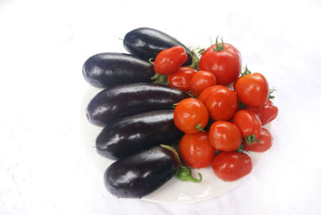 Harvest - tomatoes & eggplant, isolated -    from home garden, Pacific Northwest   Stock Photo