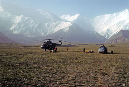 russia steppe: Climbers and Soviet helicopter