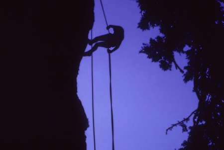 Climber on rappel, silhouette,  Obsidian Cliffs, Oregon Cascades