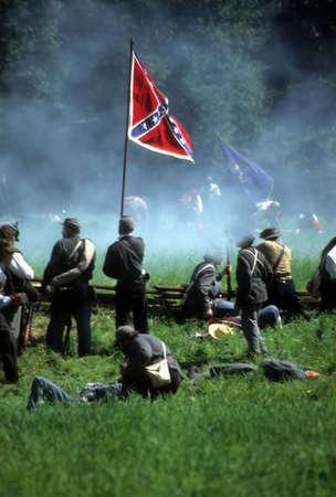 Confederates defend the flag,  Civil War battle reenactment      Stock Photo
