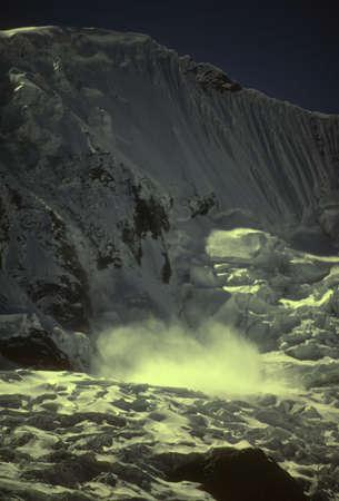 cordillera: Avalanche on Copa icewall,  Cordillera Blanca, Peru, South America   Stock Photo