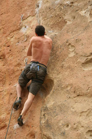 climber clinging to rock face,  Smith Rock State Park,  Central Oregon  photo