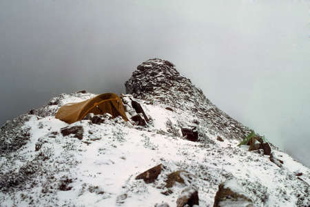 Snowstorm traps hikers in their tent on a mountain ridge,  North Cascades Washington   Imagens
