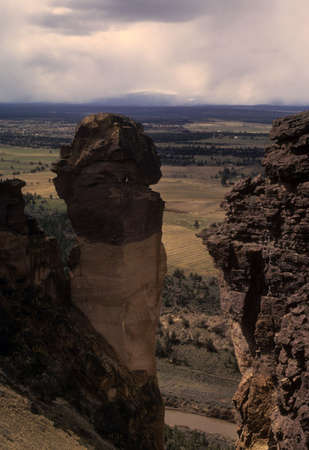 Tiny climbers on climb of Moneky Face, Smith Rock State Park,  Oregon cascades