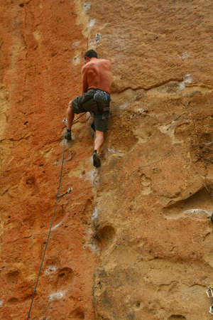 Bare back climber clinging to rock face,  Smith Rock State Park,  Central Oregon   photo