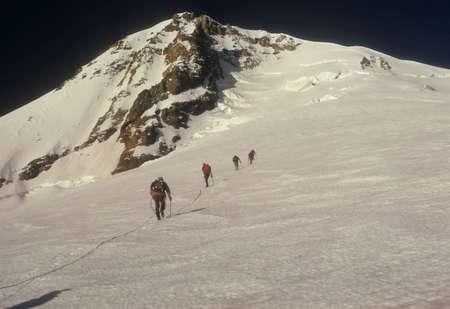 Rope team of climbers on Sunshine Route Mt. Hood Cascades Oregon   Фото со стока