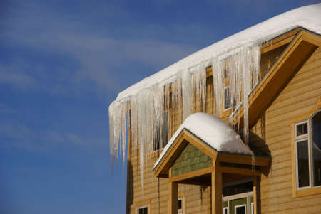 Large icicles on Townhouses after heavy snowstorm,Steamboat Springs,Colorado, Rocky Mountains