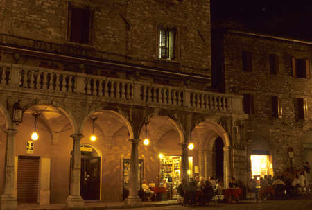 Evening Café, customers watching the  passagiatta.  Assisi, Umbria, Italy   Stock Photo