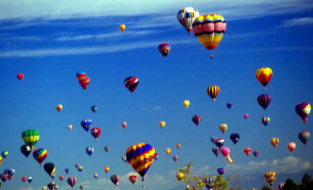 hot air balloons: Hot air balloons agaisnt blue sky,  International Balloon Festival,  Albuquerque,  New Mexico   Stock Photo