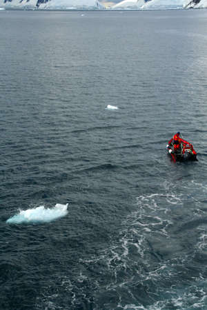 Polar landing boat,with small iceberg in bay,   Petermann Island, Antarctica  版權商用圖片