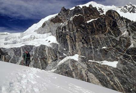 Climber approaching the pass in new snow, Chyungma Pass Khumbu Himalaya, Nepal