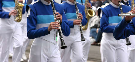 marchers: Blue clarinet & winds players in marching band Calgary Stampede Parade Calgary Alberta