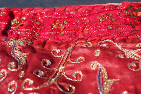 Rajasthani wall hanging made of quilted saris, detail, red patterns
