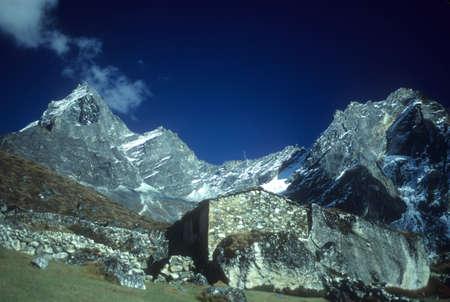 Mountain hut and Khumbu peaks,  Khumbu Himalaya, Nepal, Asia   Stock Photo