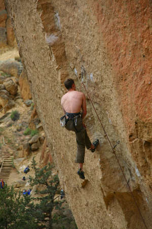 Climber on overhanging cliff route,Smith Rock State Park, Central Oregon