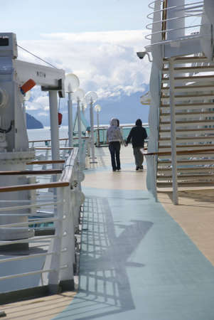 Young couple holding hands on brisk morning on cruise ship deck,  Juneau, Alaska