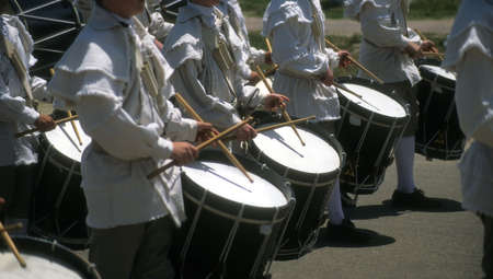 Drummers in white colonial uniforms,		Williamsburg,	Virginia,