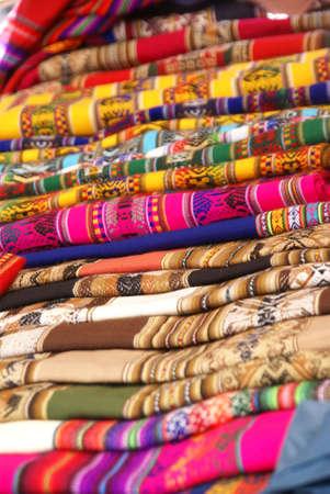 Colorful handmade blankets & tablecloths, Pisac market,  Cusco, Peru, South America