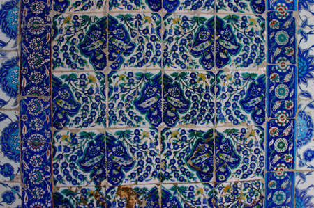 Iznik tiles, intricate patterns, with dappled shadows, just before noon prayersEyup Mosque,IstanbulTurkey