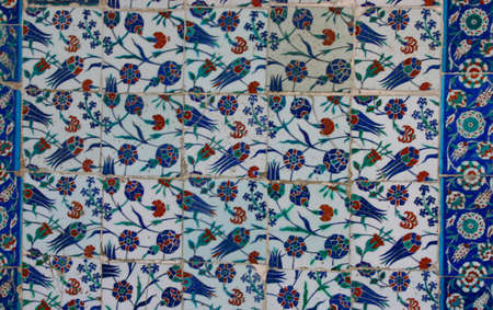 dappled: Iznik tiles, intricate patterns, with dappled shadows, just before noon prayers Eyup Mosque, Istanbul Turkey  Stock Photo