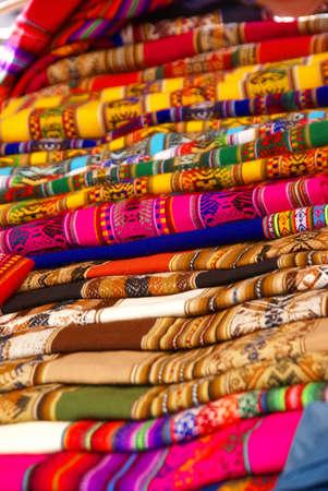 quechua: Colorful handmade blankets& tablecloths, Pisac market,  Cusco, Peru, South America   Stock Photo