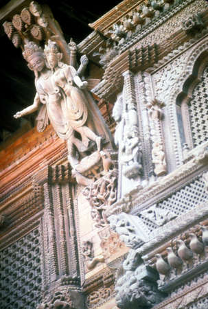 struts: Intricately carved temple struts, windows and roof,   Kathmandu Nepal, Asia