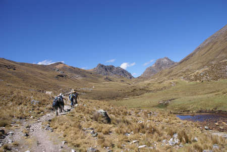 Hikers on trail in high Andes, Cordillera Huayhuash, Andes, Peru, South America   Stock Photo