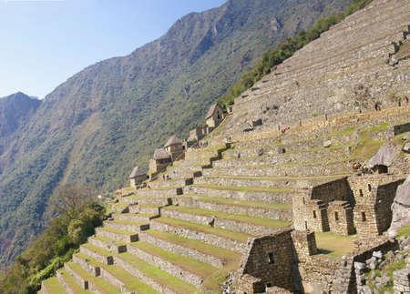 Terraced fields and guardian huts, Inca ruins Machu Picchu,Peru, South America  Stockfoto